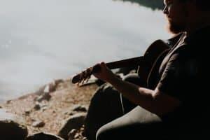 man singing sitting down